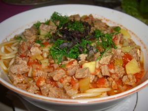 Laghman, an Uzbek soup-stew staple is chock full of spaghetti, potatoes, tomatoes, herbs and meat.